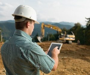 Construction site worker using MapGage to track site assets and inspecting.